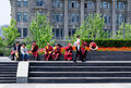 Buddhists monks on the bund in shanghai buddhist and chinese people sitting down at waitan china a bright sunny day Stock Photos