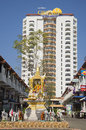 Buddistsky the altar on the background of a modern hotel Golden Beach Cha-Am. Cha-Am, Thailand Royalty Free Stock Photo
