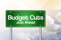 Budget Cuts Green Road Sign Royalty Free Stock Photo