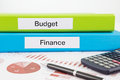 Budget and finance documents with reports words on labels document binders graphs business Royalty Free Stock Photography