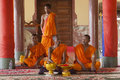 Budhist monks in their temple buddhist monasticism is one of the earliest forms of organized monasticism in the history of Stock Photography