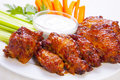 Buffalo chicken wings with cream cheese dip Royalty Free Stock Photos