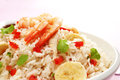 Buffet food rice salad with a mango vinaigrette dressing salad includes prawn or shrimp roast chicken banana tomato and coriander Stock Image