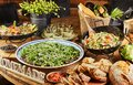 Buffet with a large selection of vegetable dishes and salads and Italian bread, healthy food Royalty Free Stock Photo