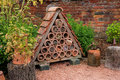 Bug or insect house a showing ceramic tubes filled with material ti encourage insects to breed Royalty Free Stock Photography