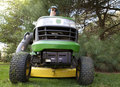 Bug's-Eye View of Man on Riding Lawnmower Royalty Free Stock Photo