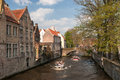 Buges architecture old canal with boats the fence buildings in bruges Royalty Free Stock Images