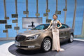 Buick lacrosse a light brown mid size luxury car with model in auto show guangzhou Royalty Free Stock Image
