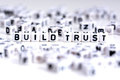 Build trust process concept with tiled letters on white background Royalty Free Stock Photo