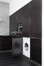 Build-in washing machine and cooker on kitchen Royalty Free Stock Photos