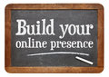 Build your online presence internet marketing concept a text on a vintage slate blackboard Royalty Free Stock Images