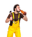 Builder with beer and hammer on a white background Royalty Free Stock Image
