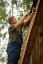 Builder or carpenter working and builds a roof Royalty Free Stock Photo