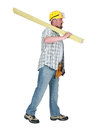 Builder carrying timber over his shoulder Stock Photo