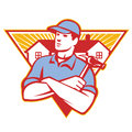 Builder construction worker hammer house illustration of a with arms crossed with in background set inside triangle done in retro Royalty Free Stock Photos