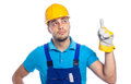 Builder construction worker thoughtfull pointing up to something isolated on white background Royalty Free Stock Photography