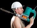 The builder with a drill of the big diameter Stock Photos