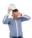 Builder engineer or architect wiping his brow removing hardhat and with hand isolated on white Stock Photography