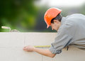 Builder erects a wall Royalty Free Stock Photo