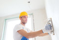 Builder with grinding tool indoors business building profession and people concept Royalty Free Stock Photo