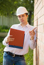 Builder in hardhat with documents Royalty Free Stock Photos