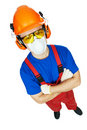 Builder in hardhat, earmuffs, goggles and gas mask Stock Photography