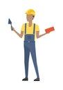 Builder in Helmet and Blue Uniform. Brick. Trowel Royalty Free Stock Photo