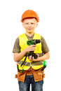 Builder helmet boy in a plays in the with tools isolated Stock Photo