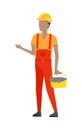 Builder in Helmet and Uniform. Bucket of Cement Royalty Free Stock Photo