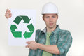 Builder holding recycling symbol Royalty Free Stock Photos