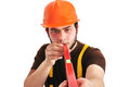 Builder holding wasserwaage on a white background Stock Photos