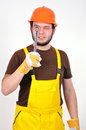 Builder holding wrench on a white background Stock Photo