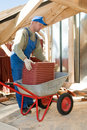 Builder roofer and wheel barrow Royalty Free Stock Photo