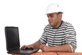 Builder sat using laptop a Royalty Free Stock Image