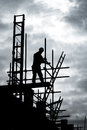 Builder on scaffold building site Royalty Free Stock Images