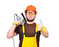 Builder showing thumb up holding drill and Stock Image
