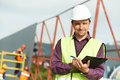 Builder site manager worker at construction site Royalty Free Stock Photo