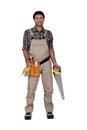 Builder smiling with saw. Royalty Free Stock Images