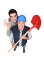 Builder stood with young apprentice his Royalty Free Stock Images
