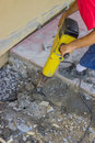Builder worker with electric jackhammer repairing sidewalk crack Royalty Free Stock Photography
