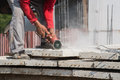 Builder worker with grinder machine cutting concreate floor Royalty Free Stock Photo
