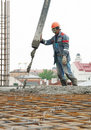 Builder worker pouring concrete Royalty Free Stock Images