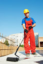 Builder worker at roof insulation work Stock Images