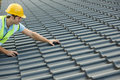 Builder Working On Roof Of New Building Royalty Free Stock Photo