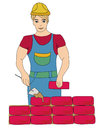 Builder working. Working mason makes laying bricks Stock Photo