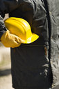 Builder with yellow hard hat under construction concept natural light selective focus Royalty Free Stock Photography