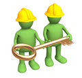 Builders - puppets, holding in hands a gold key Stock Photo