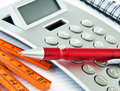 Building activity with calculator and pen Royalty Free Stock Image