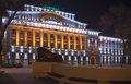 Building the bank of russia lit decorative illumination rostov on don november in foreground is a statue a lion near Stock Photo