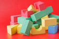 Building blocks on red background Royalty Free Stock Photo